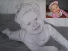 portret bebelus cu boneta